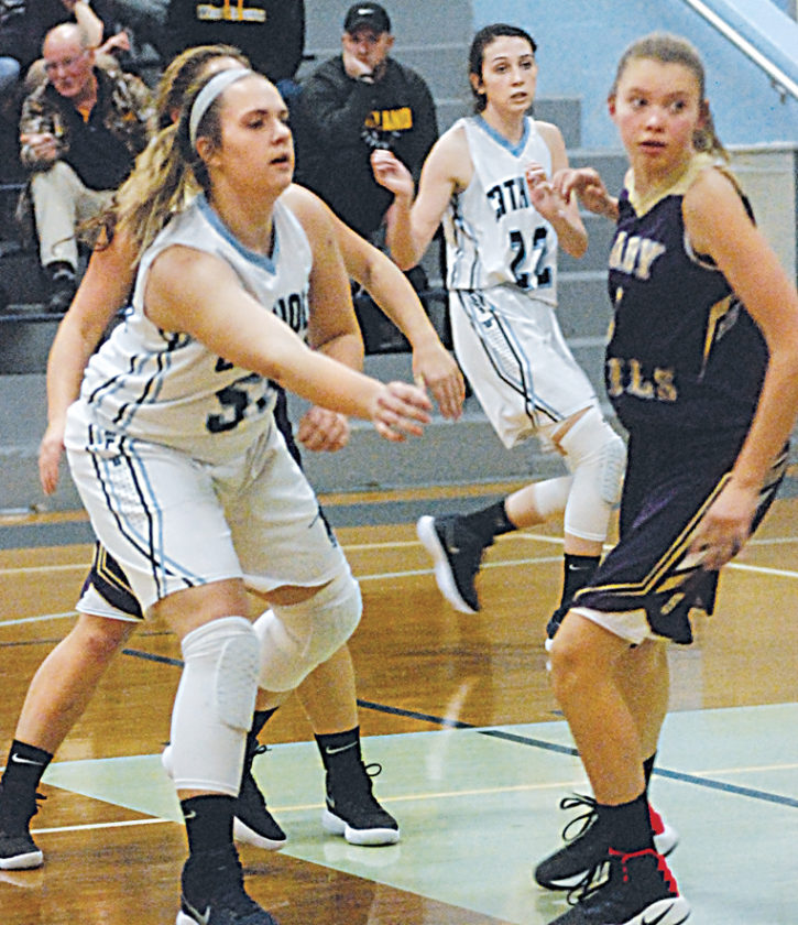 Parkersburg Catholic's Emma Gardner (50) lets go of a pass as St. Marys' Ciara Bennett (right) and PCHS teammate Madison Ross (22) watch Thursday night. Catholic won 71-39. Photo by Steve Hemmelgarn.