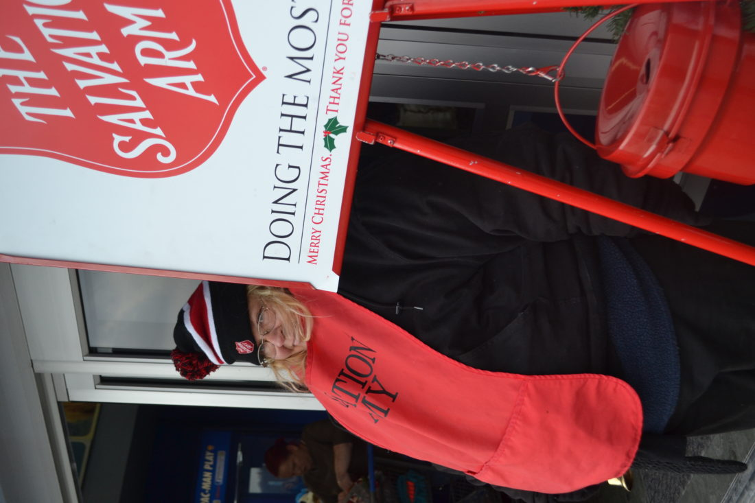 KATE YORK The Marietta Times Tava Douglas of Marietta a bell ringer for 20 years takes donations outside the Marietta Walmart on Thursday