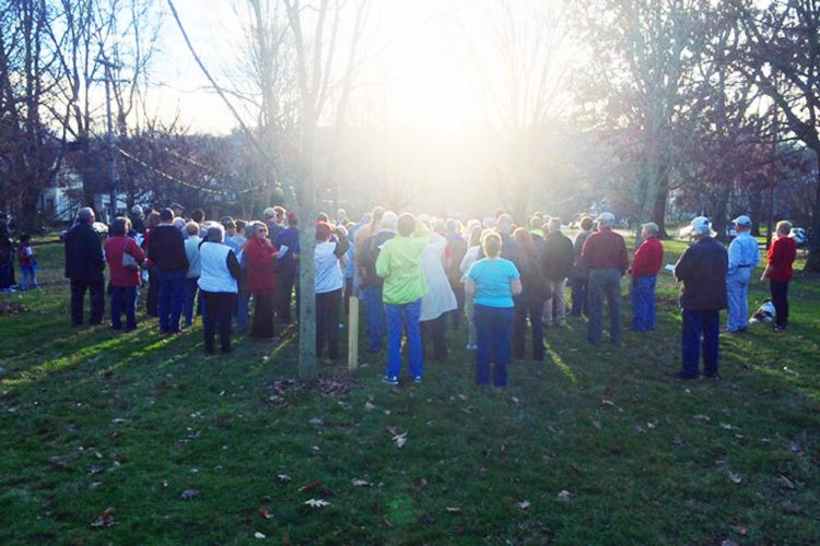Photo submitted by Kyle Yoho People gather at Sacra Via Park to witness the sun set over Harmar Hill during a past Solstice Watch.