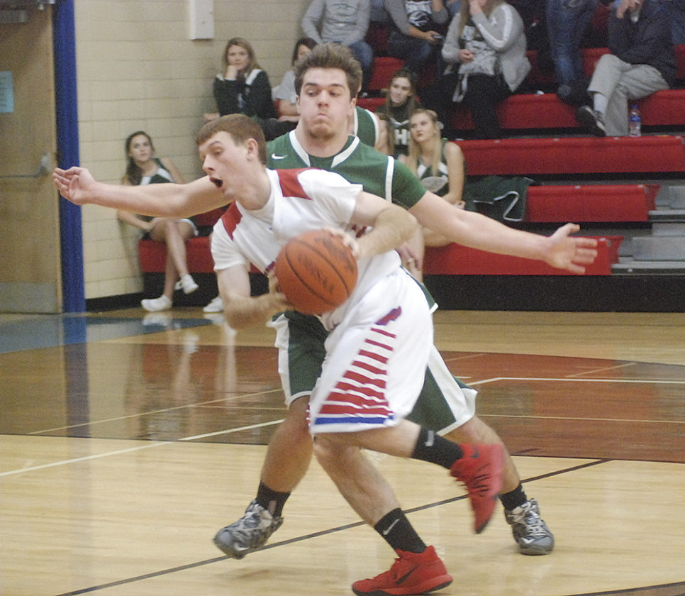 Fort Frye's Luke Nelson looks to pass as Shenandoah's Nick Miller defends during a high school boys basketball game Friday night in Beverly.  JORDAN  HOLLAND The Marietta Times