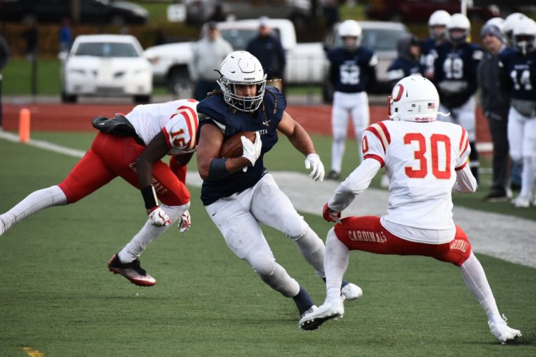 Photo courtesy of Nate Knobel Photography Marietta College's Roger Walker carries the ball during a college football game against Otterbein this season at Don Drumm Stadium.