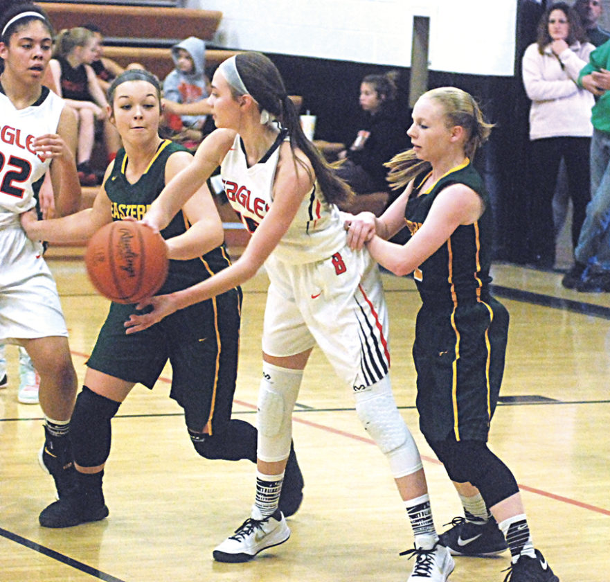 Belpre's Abbey LaFatch, center, looks to pass as Eastern's Kelsey Casto, left, and Jess Parker, right, defend during a high school girls basketball game Saturday. Photo by Steve Hemmelgarn.