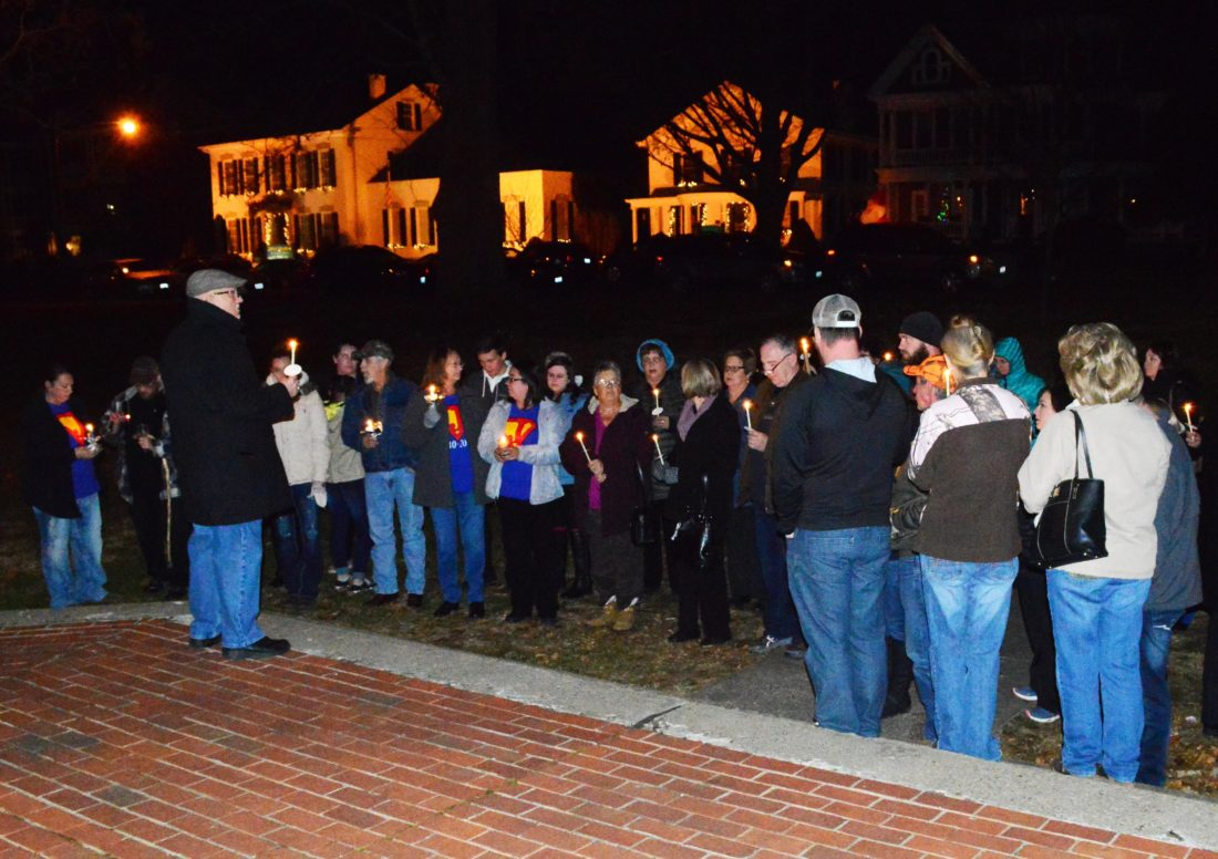 Doug Loyer Special to The Times Candles are lit during the Hope for the Holidays Candlelight Vigil.