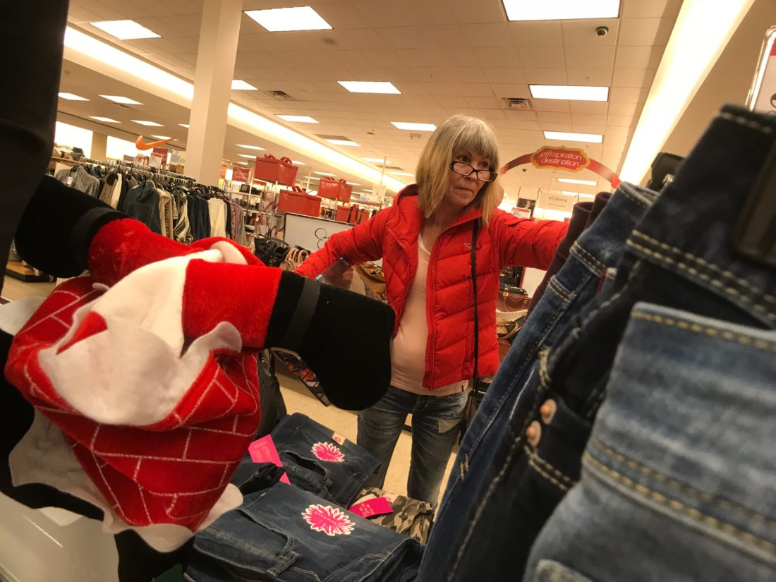 JANELLE PATTERSON   The Marietta Times Irma Chutes, 59, of Marietta, looks through deals at Peebles Monday in search of final gifts for her grandsons.