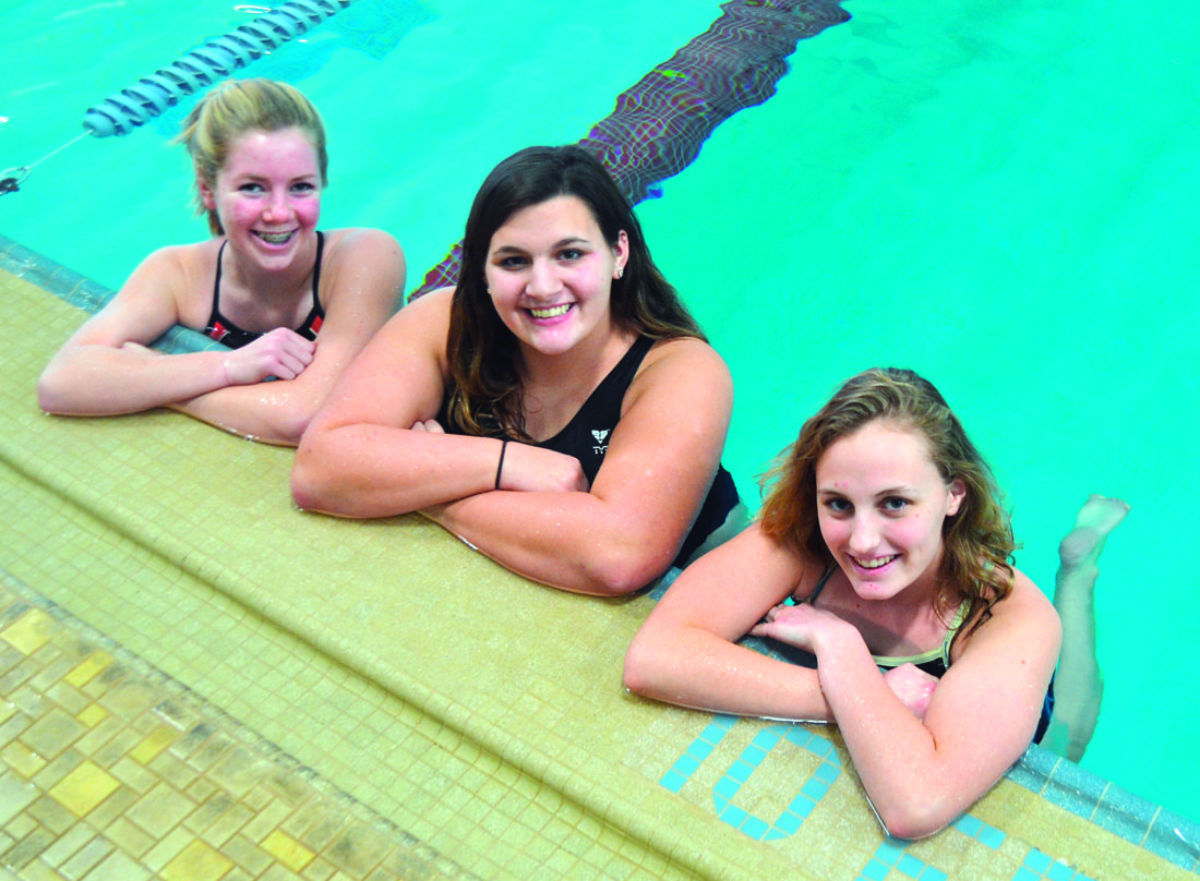 RON JOHNSTON The Marietta Times Marietta High swimmers' (left to right) Piper Halliday, Alicen Teer, and Ashley Stewart pose in the Marietta YMCA poll before a practice session Tuesday afternoon.
