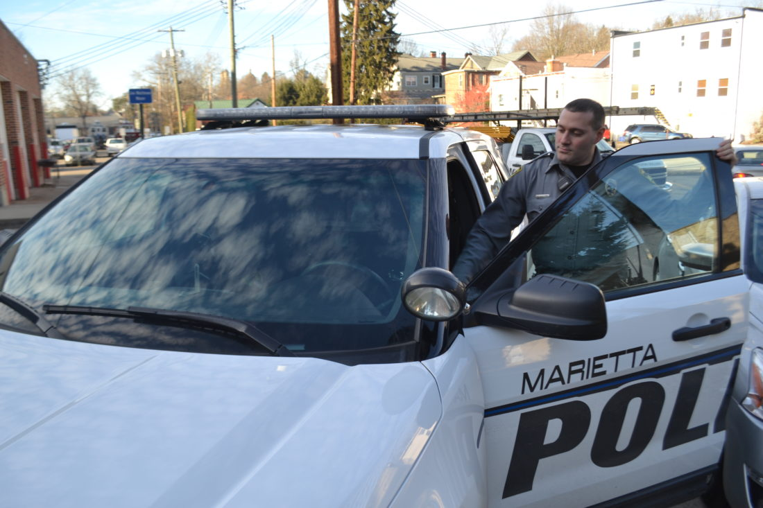 MICHAEL KELLY   The Marietta Times Marietta police officer J.D. Wallace gets into a cruiser behind the city's downtown police station on Thursday. Chief Rodney Hupp and Washington County Sheriff Larry Mincks both say drugs and associated crime and domestic problems continued to be the area's main law enforcement challenge in 2017.