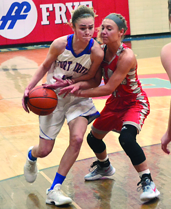RON JOHNSTON The Marietta Times Fort Frye's Morgan Borich, left, handles the ball against the defense of River's Lauren Flannery during a high school girls basketball game Thursday in Beverly.