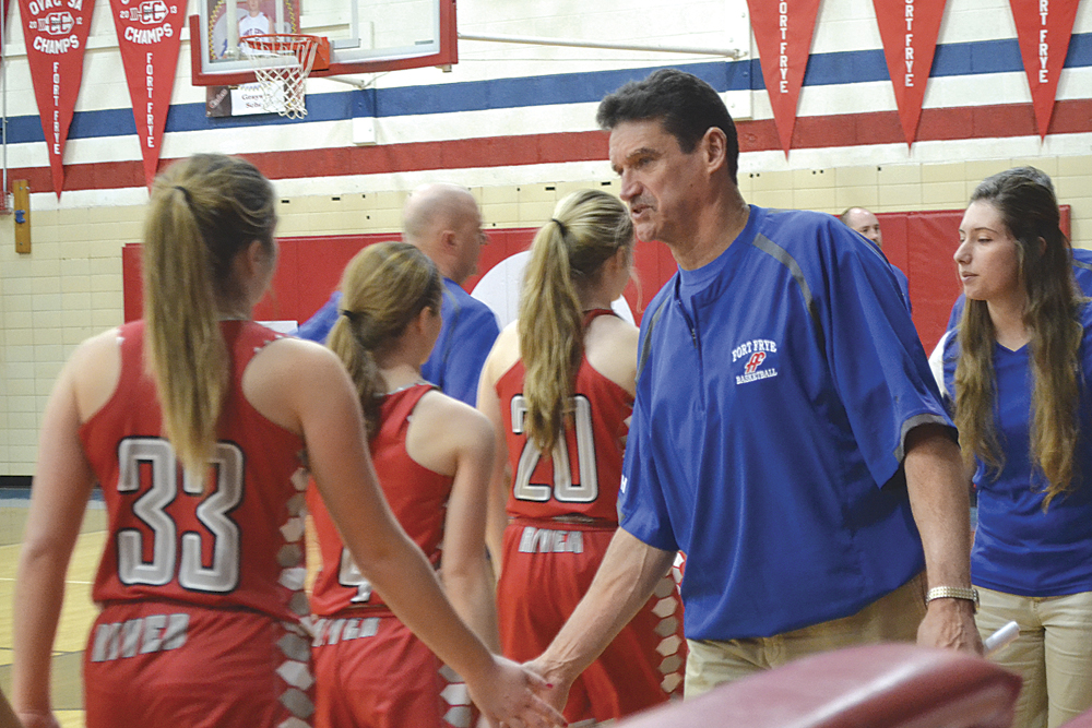 RON JOHNSTON The Marietta Times Fort Frye girls basketball head coach Dan Liedtke shakes hands with River players following Fort Frye's win Thursday in Beverly. The victory was the 600th of Liedtke's coaching career.