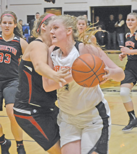 Marietta's Hannah Kroft, right, makes a move with the ball during a high school girls basketball game against Coshocton Saturday at Sutton Gym. Photo by Ron Johnston.