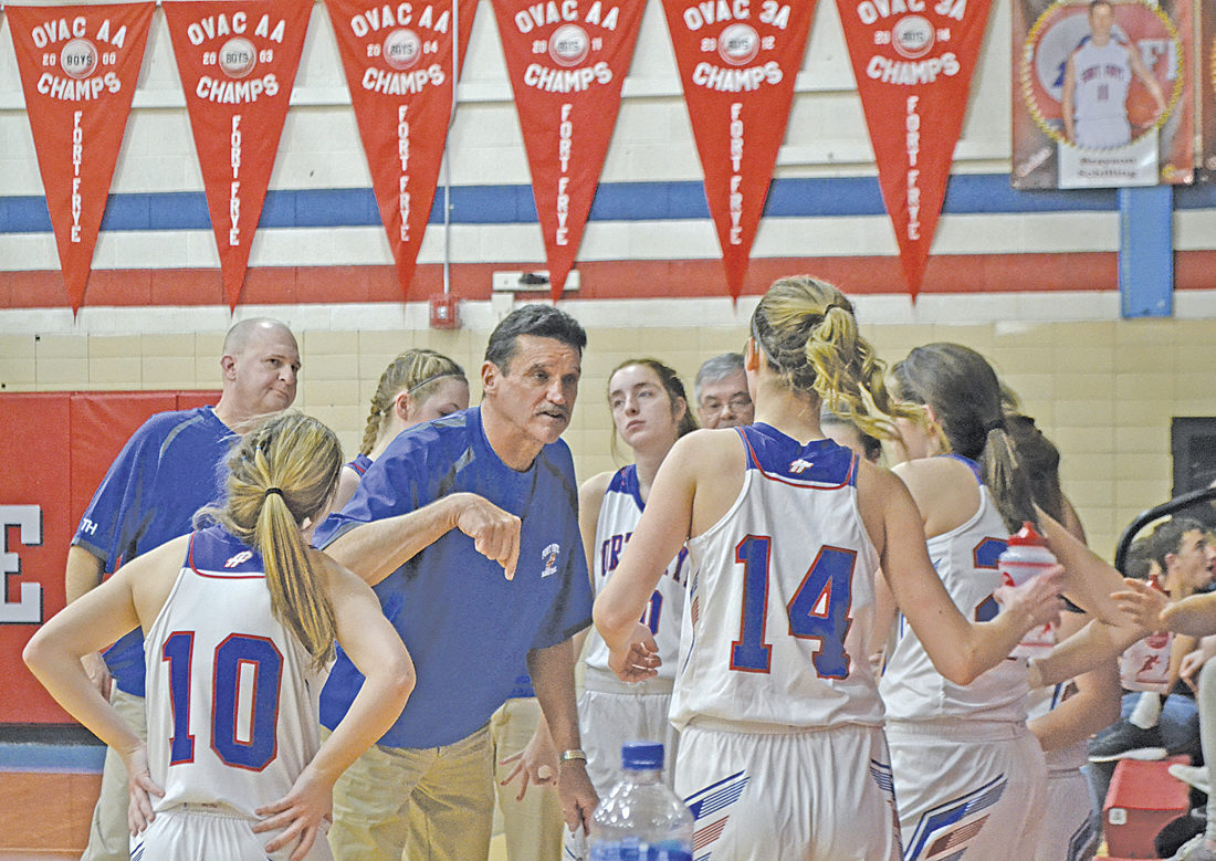 Fort Frye girls basketball head coach Dan Liedtke speaks to his team during a high school basketball game Thursday against River. Photo by Ron Johnston.