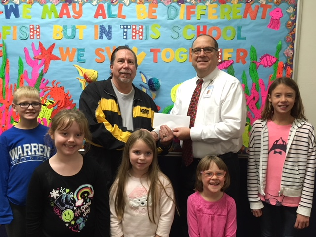 Front row, from left: A sampling of students: Mason Werry, Morgan Gillespie, Alexis Brinkman, Libby Grimm, Sydney Starcher. Back row, from left: Retired Sergeant Major Robert Hadfield and Associate Principal Joseph Oliverio.