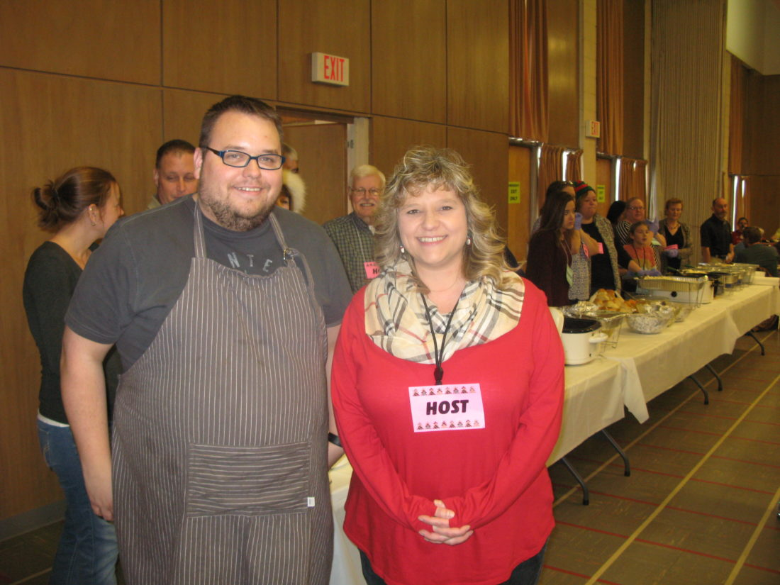 PAUL LAPANN   Special to the Times Chris Alfred and Amy Leach were determined that a 27th annual Christmas community dinner would be held this year at First Presbyterian Church in Parkersburg.