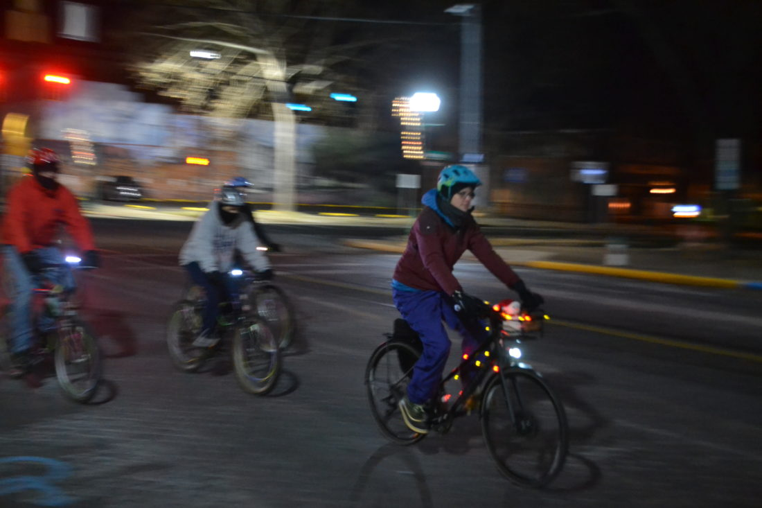 MICHAEL KELLY    The Marietta Times Riders set off down Putnam Street Tuesday night to start the 22nd annual Holiday Lights Bike Tour, several miles through the neighborhoods of Marietta to see some of the city's best decorated buildings.