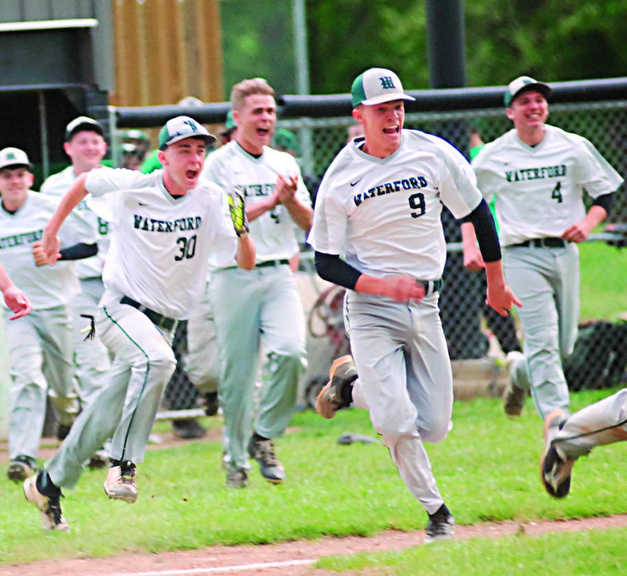 JORDAN HOLLAND The Marietta Times Waterford High baseball players celebrate Clay Hayes' walkoff RBI single against Southern last spring to finish undefeated in Tri-Valley Conference Hocking Division play.