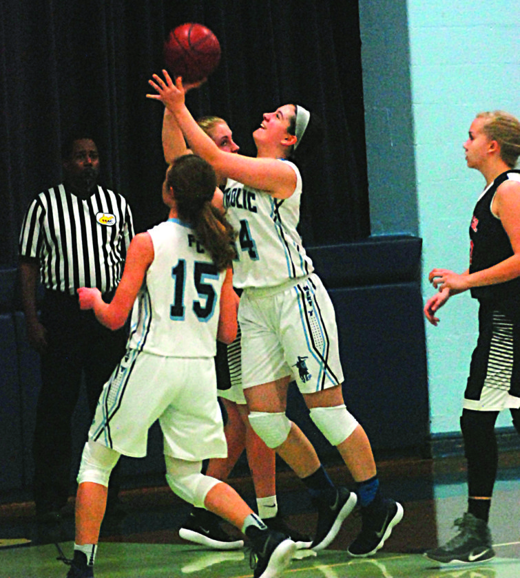 """STEVE HEMMELGARN The Marietta Times Parkersburg Catholic's Mikayla Alkire (34) goes up for a basket during a high school girls Mary """"O"""" Crusaderette Classic basketball game against Wirt County Wednesday."""