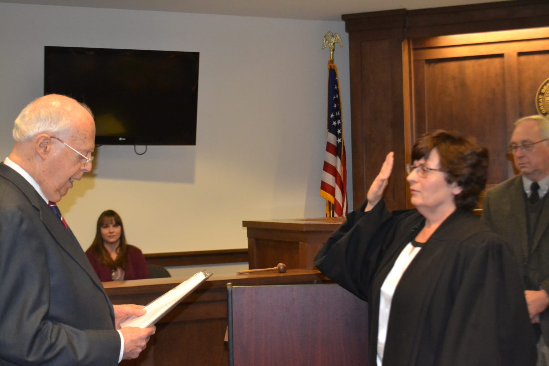 MICHAEL KELLY   The Marietta Times Marietta Municipal Court Judge Janet Dyar Welch takes the oath of office Thursday morning for her third term. The oath was administered by Marietta attorney James Addison in Courtroom A, where about 100 people attended to witness the ceremony.