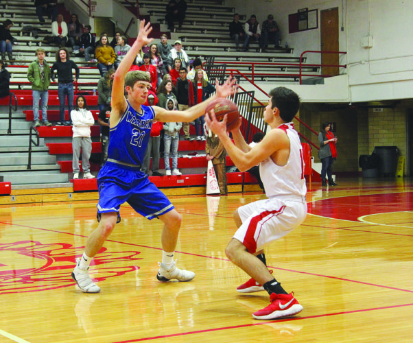 Warren's Troy Huck plays tough defense as Parkersburg's Dylan Shaver looks for someone to pass to during the Big Reds' 65-59 non-conference victory Thursday night at PHS Memorial Fieldhouse. Photo by Tom Perry.