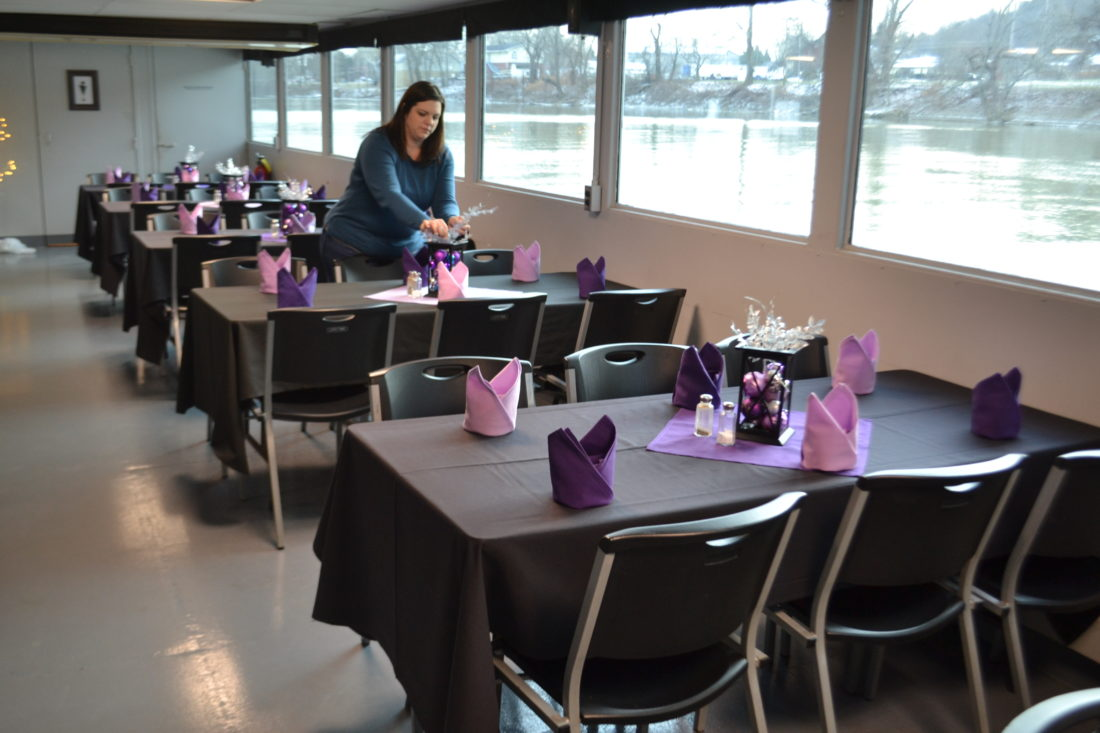 MICHAEL KELLY   The Marietta Times Heather Sands arranges tables on board the Valley Gem sternwheel boat in preparation for the New Year's cruise, which this year will involve a murder mystery game along with dinner and champagne. Sands said Friday only three seats remain for the cruise.