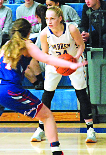 JORDAN HOLLAND The Marietta Times Warren's Molly McCutcheon is back on the court for the Lady Warriors after missing the first nine games of the season. She's planning to play college hoops at Gardner-Webb.