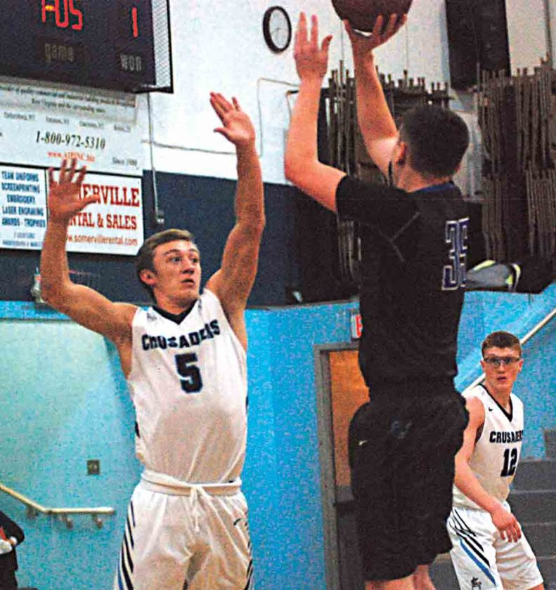JAY W. BENNETT The Marietta Times Tyler Consolidated's Tyler West (35) goes up for a shot as Parkersburg Catholic's Ty Sturm (5) contests during a high school boys basketball game Thursday.