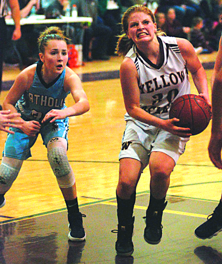 JOE ALBRIGHT The Marietta Times Williamstown's Bethany Wager, right, fights her way through traffic in the lane on the way to the hoop during the Yellowjackets' 83-66 Friday night loss to Parkersburg Catholic. Catholic's Madeline Huffman, left, looks on.