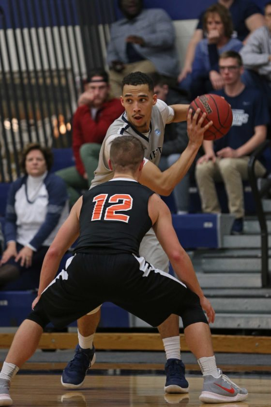 Photo courtesy of Rebecca Wheeler Marietta College's Anthony Wallace looks to pass as Ohio Northern's Nate Burger (12) defends during a college men's basketball game Saturday at Ban Johnson Arena.