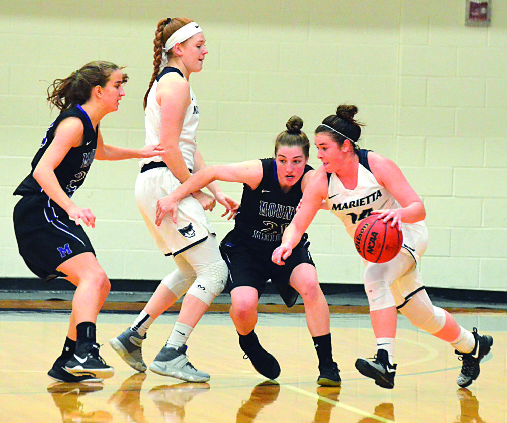 Photo courtesy of Stacy Nichols Marietta College's Brooke Borich, right, handles the ball as teammate Jenna Andersen sets a screen during a college women's basketball game against Mount Union Wednesday at Ban Johnson Arena.