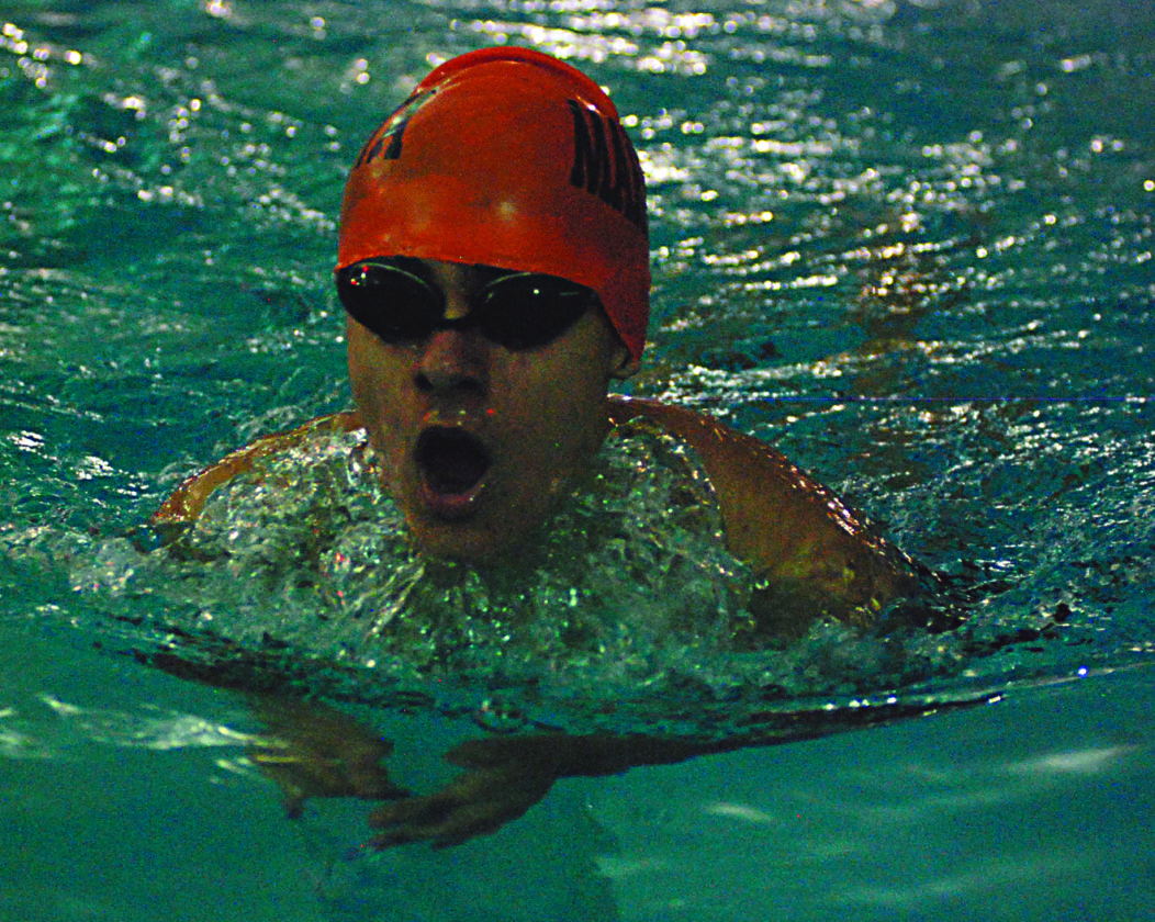 JAY W. BENNETT The Marietta Times Marietta High's Alex Temesvary competes in an event during a high school swimming match against Parkersburg High earlier this season at the Parkersburg YMCA.