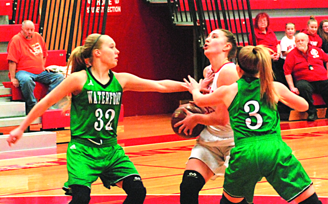Waterford's Hayley Duff (32) and Hannah Duff (3) guard Parkersurg's Madi Mace during  high school girls basketball game earlier this season at PHS Memorial Fieldhouse.   Times file photos