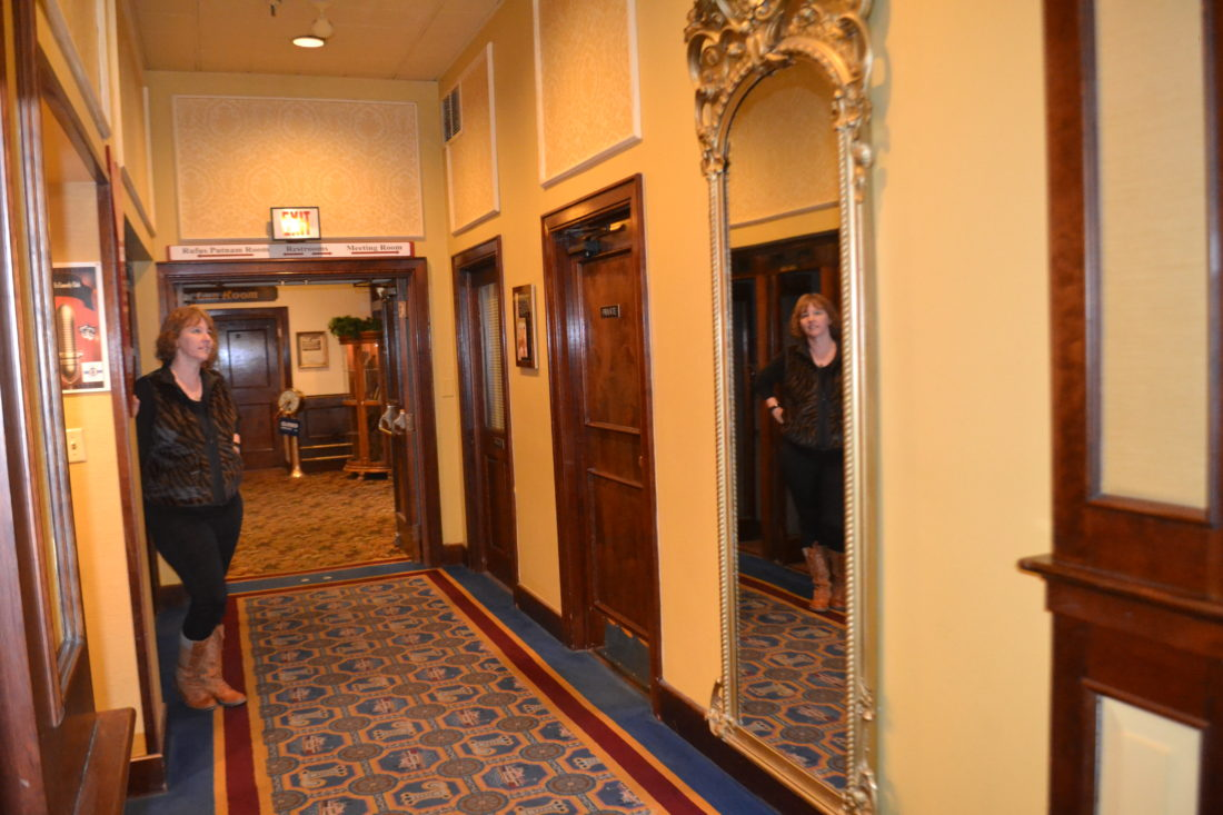 MICHAEL KELLY   The Marietta Times Missy Spicer is reflected in the massive mirror hanging in the main hallway of the Lafayette Hotel, which she said had to be removed from the third floor because guests complained about seeing ghostly images in it. Hidden Marietta is offering a Haunted History Tour of the hotel tonight.
