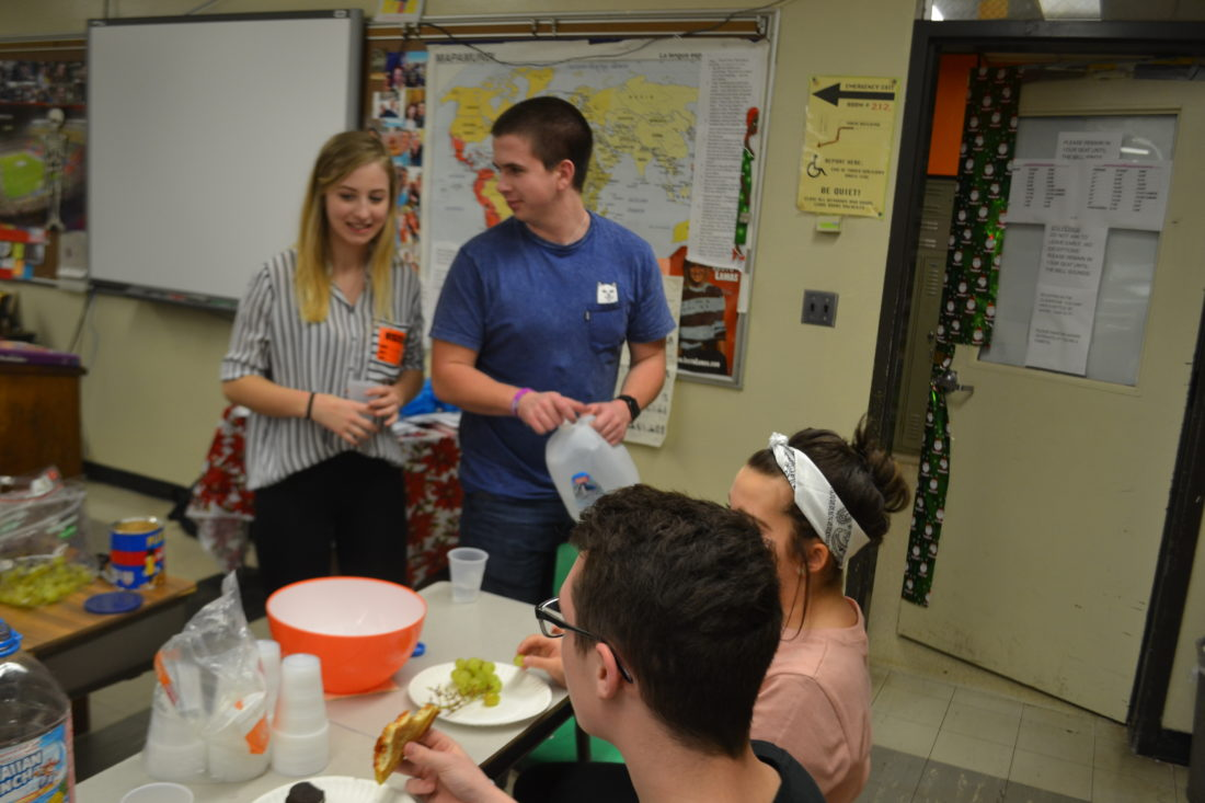 MICHAEL KELLY   The Marietta Times American Foreign Students exchange high school students Melanie Vogel from Austria and Bronislav Theuer from the Czech Republic talk to Marietta High School students while getting snacks after a presentation Friday.