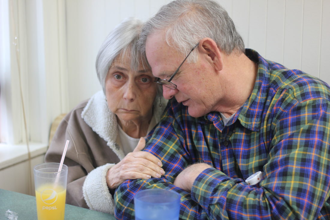 JANELLE PATTERSON   The Marietta Times Karen Henderson clings to her husband Ted Henderson Friday while at breakfast at the Busy Bee in Marietta. Ted has taken care of Karen for the last four years as her dementia has progressed into Alzheimer's.