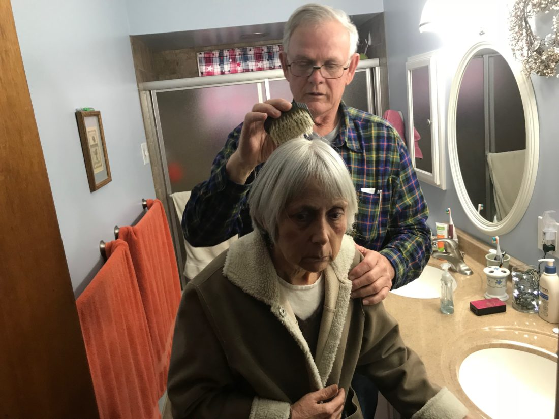 JANELLE PATTERSON   The Marietta Times Ted Henderson brushes his wife Karen's hair Friday, part of the routine he completes for his wife now that she is unable to care for herself due to Alzheimer's.
