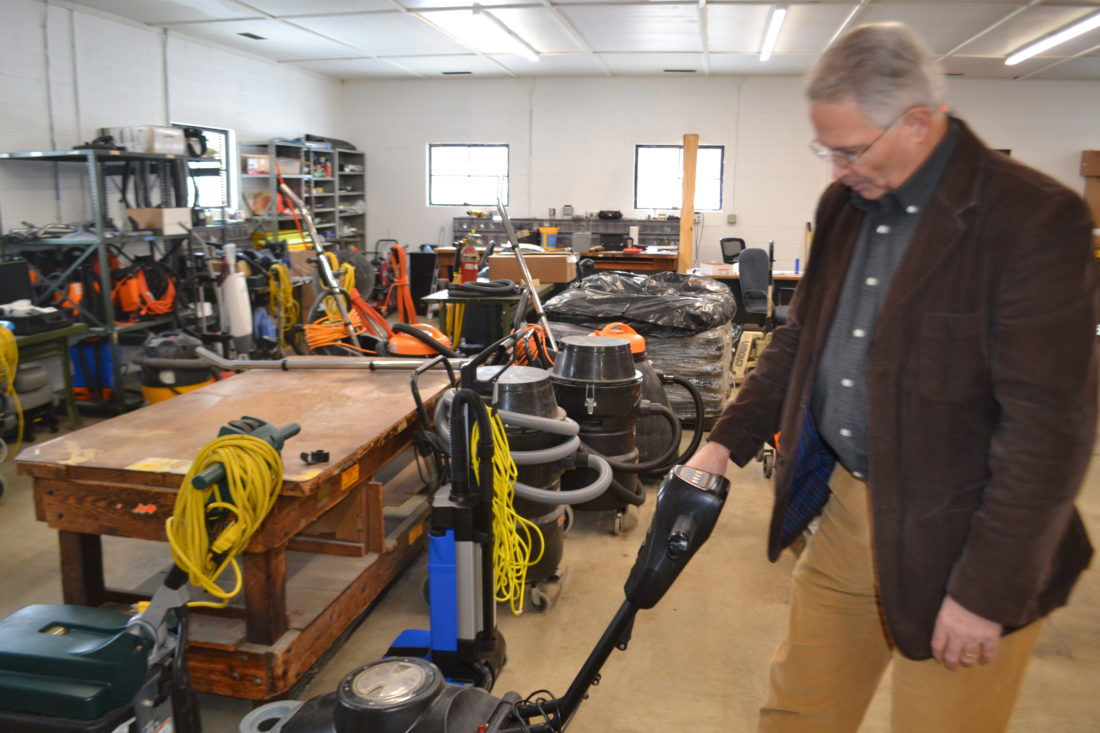 MICHAEL KELLY   The Marietta Times Ted Szabo, proprietor of Pawnee Maintenance, looks at some of  the firm's equipment in its new headquarters on Rathbone Road in Marietta on Monday. The company announced recently it has expanded its services into crime and accident scene cleanup.