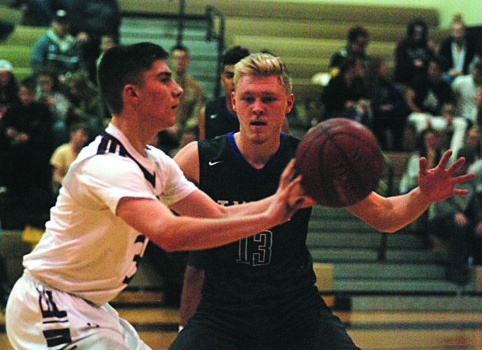 JAY W. BENNETT The Marietta Times Williamstown's Trent Lynch, left, passes as Tyler Consolidated's Griffin Phillips defends during a high school boys basketball game Thursday.