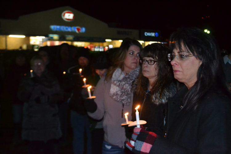 MICHAEL KELLY   The Marietta Times Lenora Lada, mother of Trey Moats, and about 30 of Moats' friends and family gathered Friday night to hold a vigil on what would have been his 27th birthday. He died of a drug overdose Dec. 2. A billboard overlooking the site of the vigil urges people to become familiar with the Good Samaritan law.