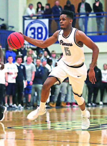 Photo courtesy of Rebecca Wheeler Marietta College's DeVaughn Wingard handles the ball during a college men's basketball game against Capital Wednesday at Ban Johnson Arena.