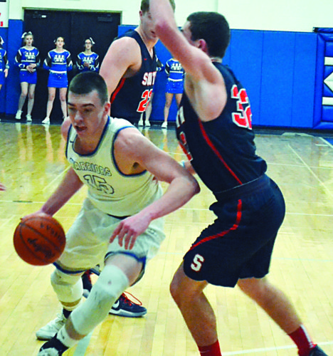 Warren's Josh Huffman, left, handles the ball as Parkersburg South's Brayden Mooney defends during a high school boys basketball game Friday in Vincent. South won, 57-50.  RON  JOHNSTON The Marietta Times