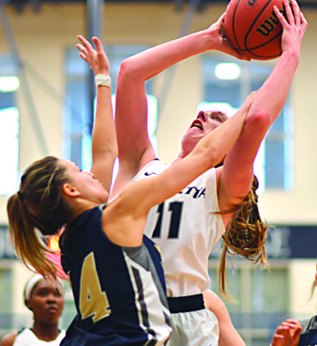 Photo courtesy of Evan Odom Marietta College's Alexis Enochs (11) goes up for a basket during a college women's basketball game against John Carroll Saturday at Ban Johnson Arena.