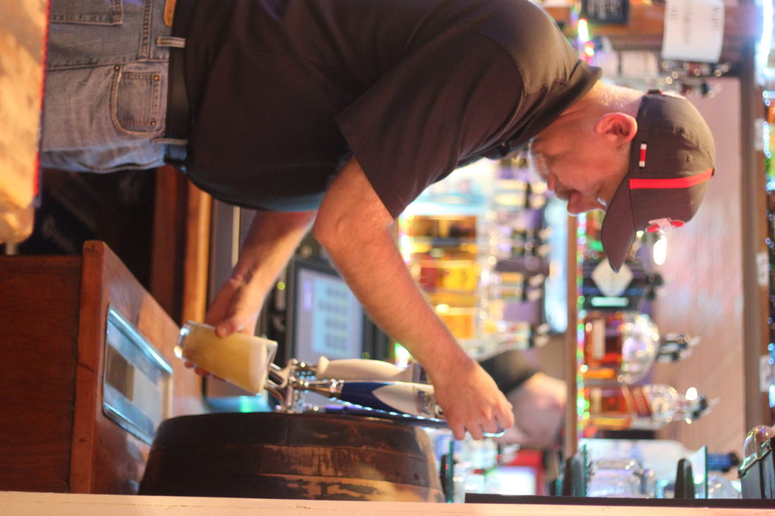JANELLE PATTERSON   The Marietta Times Chad Blair pours a beer behind the bar of the Townhouse in Marietta Monday.