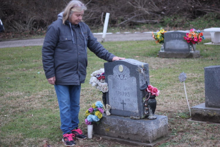JANELLE PATTERSON   The Marietta Times Helen Francis, 60, of Marietta, visits the grave of her daughter Patsy Sparks in Reno Tuesday, the day the Ohio Attorney General's Office announced Sparks' suspected killer had been indicted in Noble County.