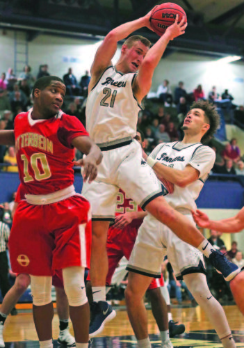 Marietta College's Kyle Dixon attacks the basket as teammate Mike Hall looks on during a college men's basketball game Wednesday at Ban Johnson Arena.  Photo  courtesy of Rebecca Wheeler