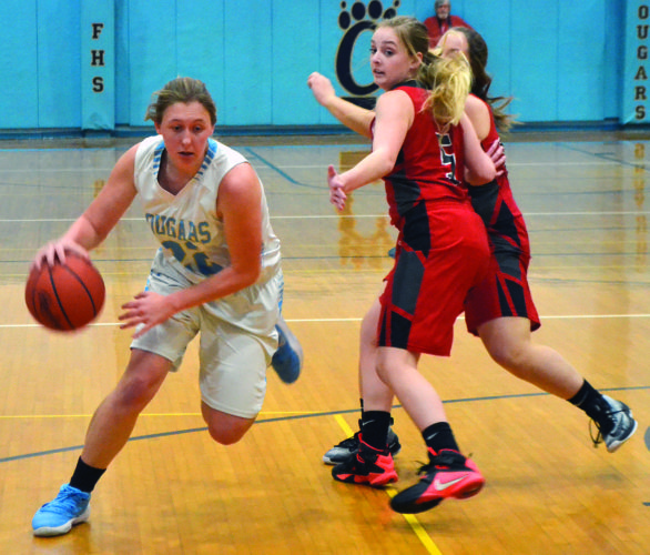 RON JOHNSTON The Marietta Times Frontier's Kylie Daugherty (22) drives with the ball past Caldwell's Chloe Siddle during a high school girls basketball game Thursday in New Matamoras.