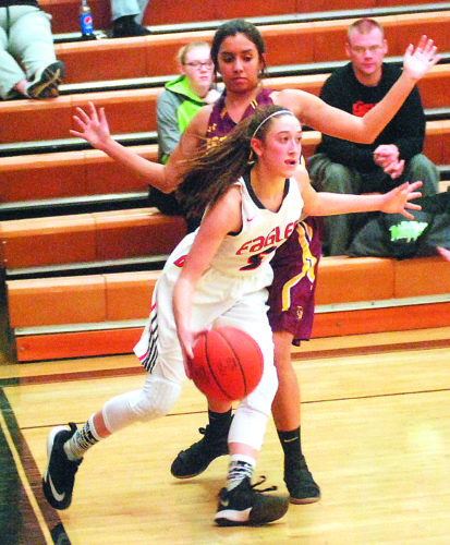 JORDAN HOLLAND The Marietta Times Belpre's Sydney Spencer (5) dribbles the ball while being defended by Federal Hocking's Tamika Mayle during a high school girls basketball game Saturday in Belpre.