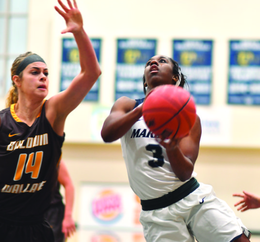 Photo courtesy of Evan Odom Marietta College's Amisha Herd, right goes up for a basket during a college women's basketball game against Baldwin Wallace's Megan Schubert Saturday at Ban Johnson Arena.