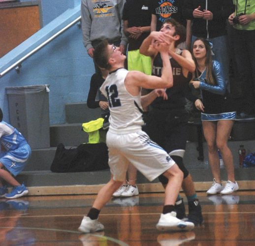 Parkersburg Catholic's Cade Ullman fights for the basketball during the Crusaders' 81-47 win over Ritchie County Tuesday night.  Photo by Steve Hemmelgarn