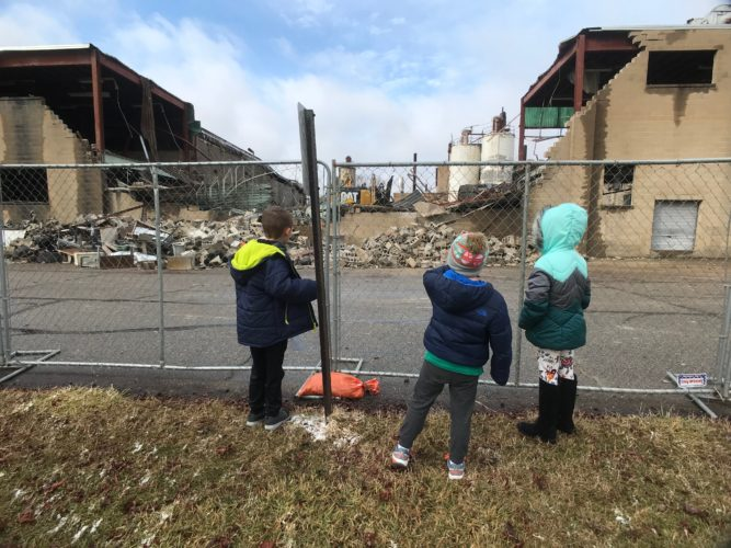 JANELLE PATTERSON   The Marietta Times Lyla Stewart, Henry Nicely and Layne Stewart, watch the demolition of the Fenton factory in Williamstown Wednesday.