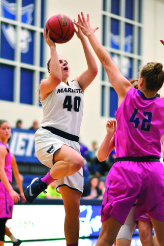 Photo courtesy of Evan Odom Marietta College's Corrie Burkhardt goes up to attempt a jump shot during a college women's basketball game against Capital Wednesday at Ban Johnson Arena.