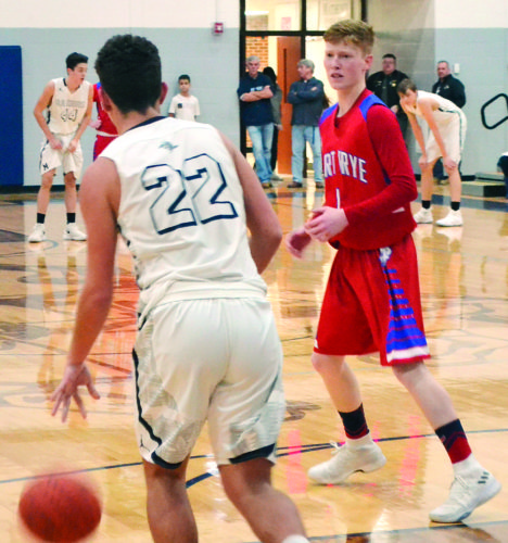 RON JOHNSTON The Marietta Times Fort Frye's Brayson Schilling, right, guards Morgan's Owen Bowen during a high school boys basketball game Friday in McConnelsville.