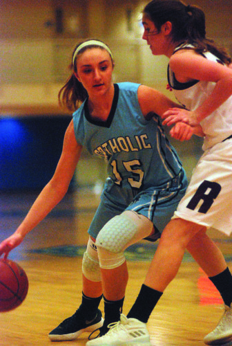Parkersburg Catholic's Olivia Ullman, left, drives on Roane County's Silkin Harlan during Saturday's game in Glenville, W.Va. Catholic won, 60-45.  JOE ALBRIGHT The Marietta Times